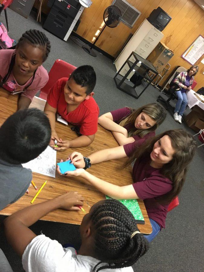 HOSA members teach Johnson Chapel Baptist Church students about healthy habits.