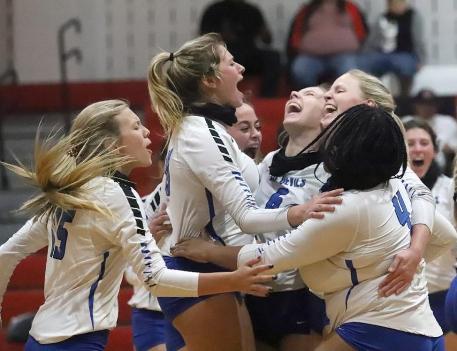 The Lady Devils celebrate after winning against Diboll in five close sets.